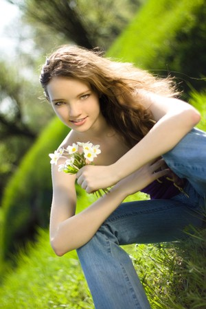 beautiful girl snowdrop bouquet in forest photo
