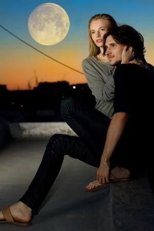 attractive couple in twilight under moon outdoor photo