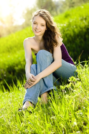 beautiful teen girl  on meadow smile Stock Photo - 7893900
