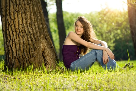 beautiful teen girl in forest smile Stock Photo
