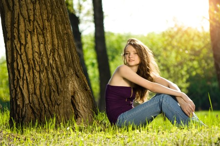 beautiful teen girl in forest smile photo