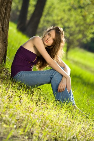 beautiful teen girl in forest photo