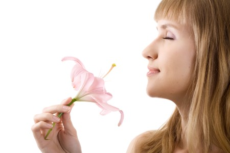 inhale: beautiful woman inhale aroma of lily isolated on white Stock Photo