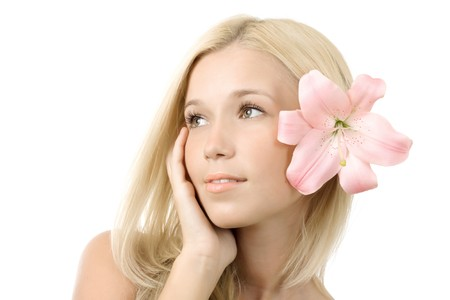 Beautiful young blonde woman with lily flower isolated photo