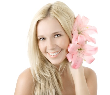Beautiful young blonde woman with lily flower smile isolated Stock Photo - 7893893