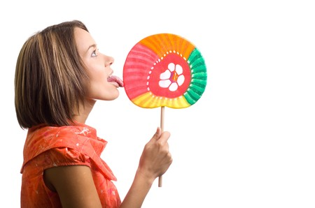 appealing attractive: beautiful young woman with a lollipop in her hand sideview isolated Stock Photo