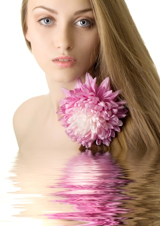 lovely woman with purple flower in water Stock Photo - 7893865