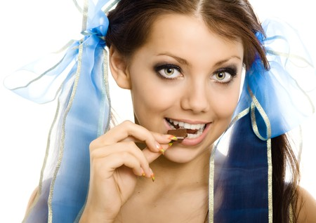 pigtails girl with chocolate enjoy closeup isolated  photo