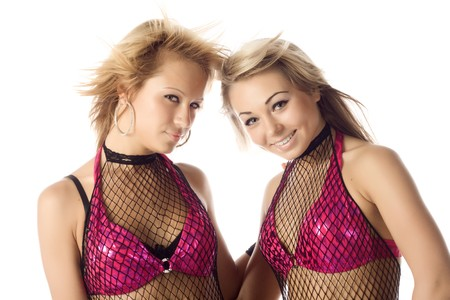 portrait of two attractive dancers in netting costumes isolated photo