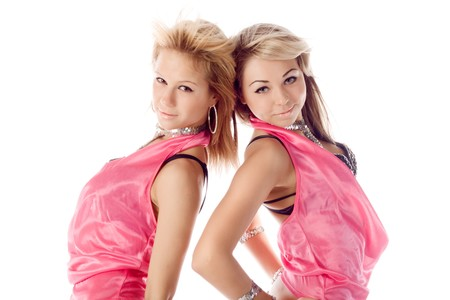 portrait of two attractive dancers in pink costumes isolated photo