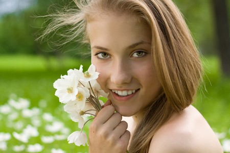 pretty teen girl with white bouquet near the face photo
