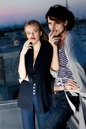 stylish couple smoking outdoor on the night photo