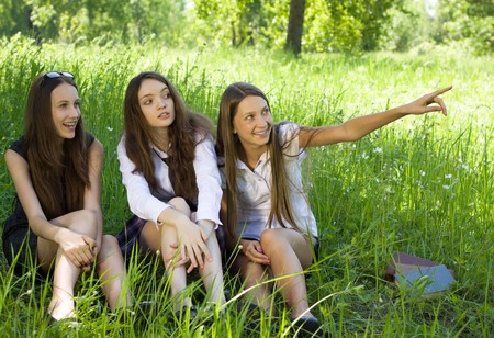 three beautiful student girls spend time in the park Stock Photo - 7894015