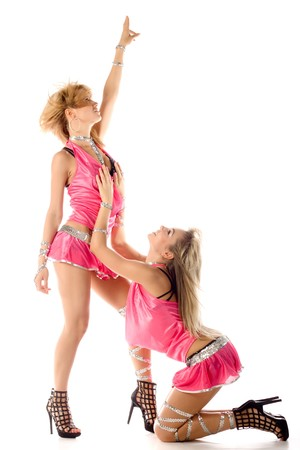 two beautiful dancer girl in pink costumes isolated photo