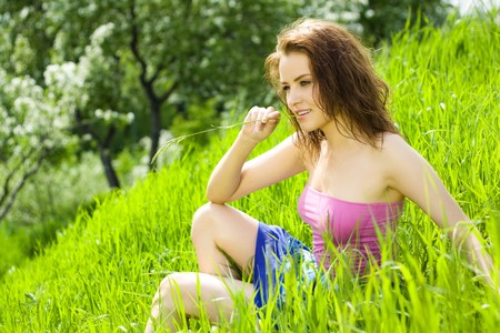 reverie: Young beautiful woman reverie in grass Stock Photo