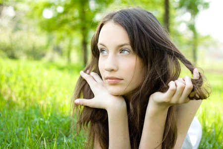 young brunette teenager girl on meadow photo