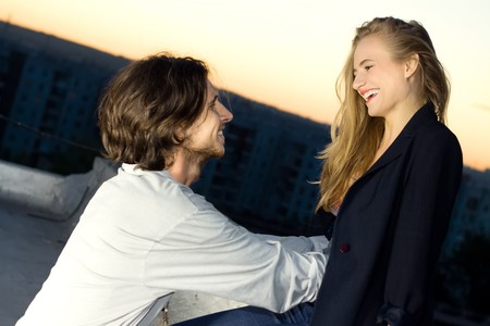cordiality: young woman and man happy smiling Stock Photo