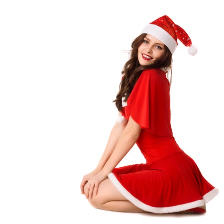 alluring women: happy smiling woman in red xmas sexy costume isolated
