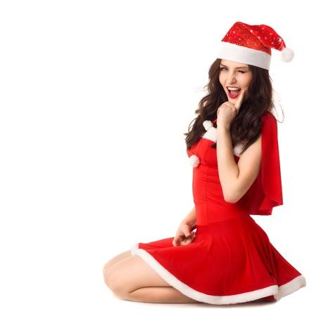 feliz mujer sonriente en rojo traje de sexy xmas aislado