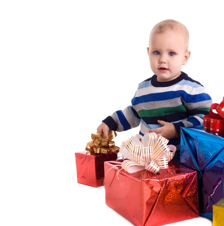 pretty baby boy with gifts isolated photo