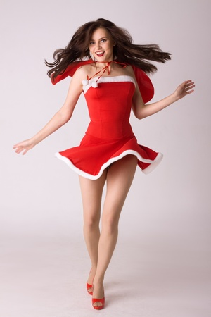 very happy smiling woman in red xmas sexy costume photo
