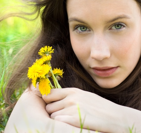 innocent: young beautiful teenager with dandelion bouquet Stock Photo