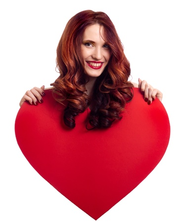 Valentines Day. Woman holding Valentines Day heart sign with copy space photo