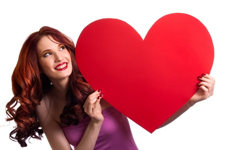 valentine: Valentines Day. Woman holding Valentines Day heart sign with copy space Stock Photo