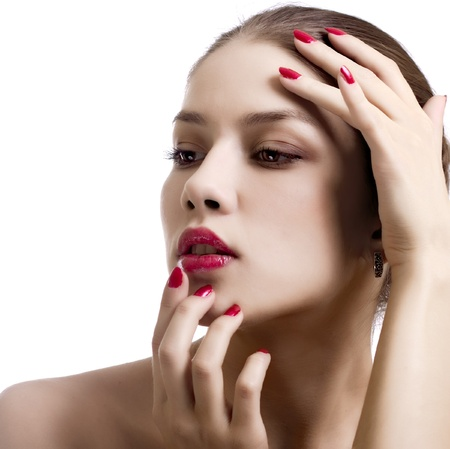 Close-up portrait of sexy caucasian young woman with red bright manicure  photo