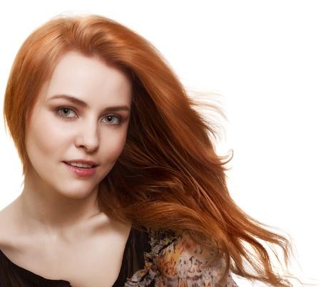 Retrato de una hermosa mujer con cabello magn�fico en blanco Foto de archivo