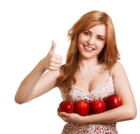 antioxidants: Young happy smiling woman with four red apple isolated on white