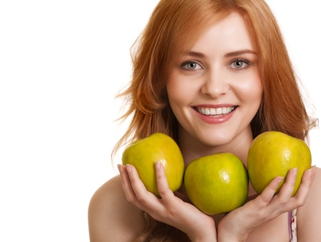 Young happy smiling woman with three green apple isolated on white photo