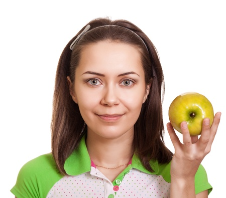 Young happy woman with green apple isolated on white  photo