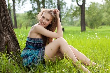 beautiful teen girl in blue dress on the meadow photo