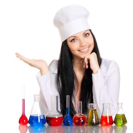 Young scientist at the table with test tubes on white background photo