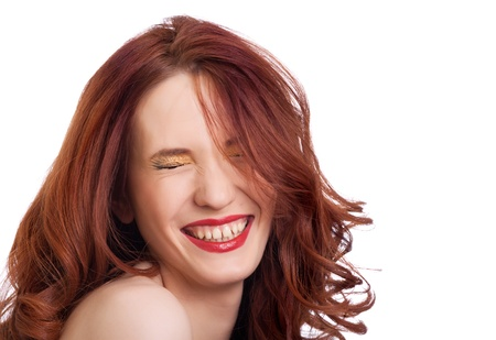 squint: attractive smiling woman squint eyes on white background