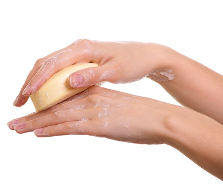 soaping: Female hands in soapsuds isolated on white Stock Photo