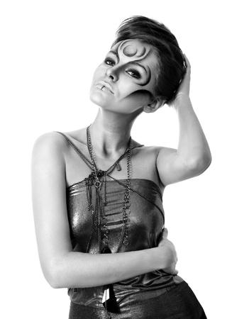 Portrait of beautiful woman with silver bodyart - bw image photo