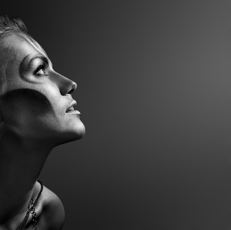 close-up portrait of beautiful woman with silver bodyart - bw image photo