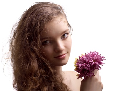 Portrait of beautiful teenager girl with flower isolated  photo