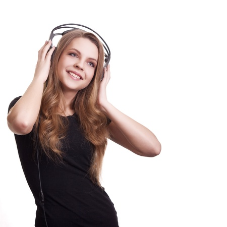 attractive smiling woman with headphones on white background Stock Photo - 9149343