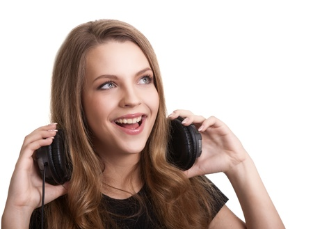attractive smiling woman with headphones on white background Stock Photo - 9149320