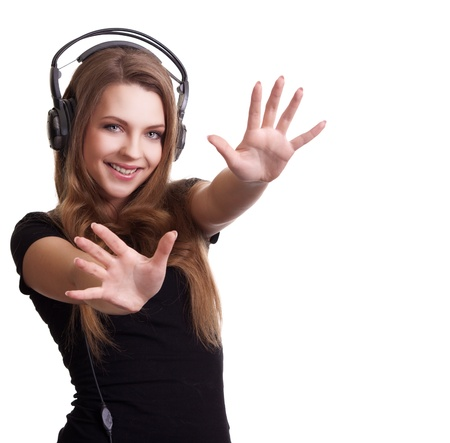 attractive smiling woman with headphones on white background Stock Photo - 9149128
