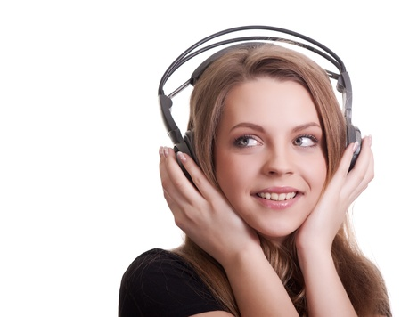 attractive smiling woman with headphones on white background Stock Photo - 9149176