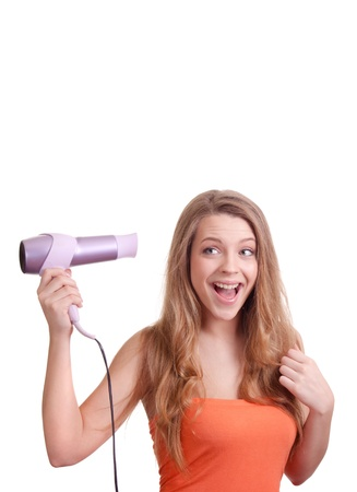 flaunt: Beautiful woman drying her hair with hairdryer