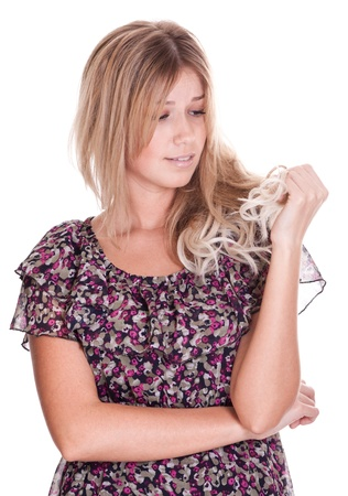 discontent: Casual blonde woman with problem hair on white background Stock Photo