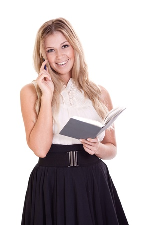 Blond businesswoman with notebook and pen isolated on white  Stock Photo - 9323290