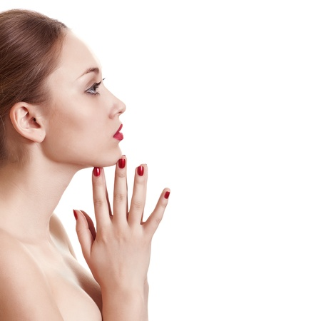 sideview portrait of beauty woman with red bright manicure on white background photo