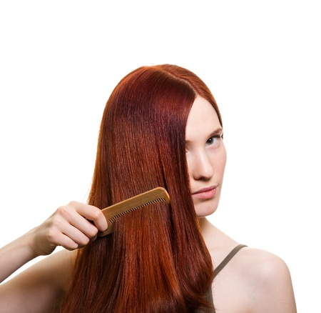 portrait of a beautiful young woman comb wonderful hair Stock Photo - 9369466
