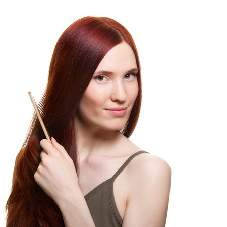 portrait of a beautiful young woman comb wonderful hair  Stock Photo - 9369464